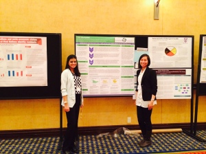 Poster presentation by Katia Wong (right), Co-director, CSIH MentorNet and Shweta Dhawan (left), Program Liaison, CSIH MentorNet
